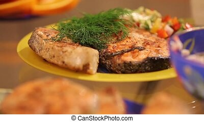 Serve salmon with vegetables - Two servings of grilled...
