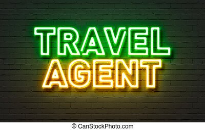 Travel agent neon sign on brick wall background. - Travel...