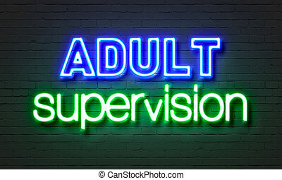 Adult supervision neon sign on brick wall background. -...