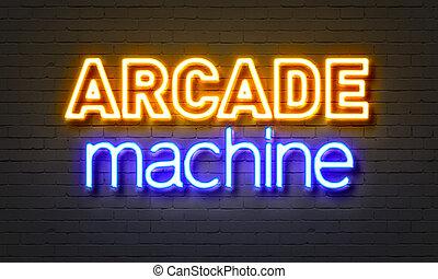 Arcade machine neon sign on brick wall background. - Arcade...