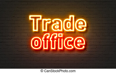 Trade office neon sign on brick wall background.