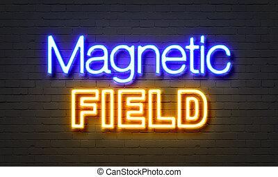 Magnetic field neon sign on brick wall background. -...