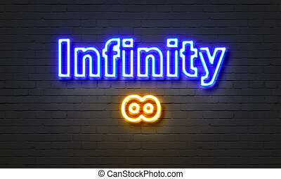 Infinity neon sign on brick wall background.