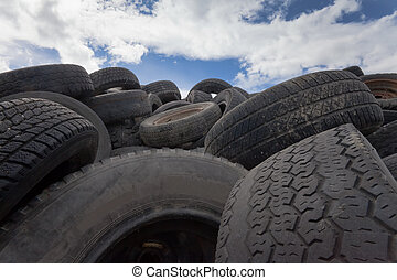 Avalanche of old tires - Pile of old tires and wheels for...