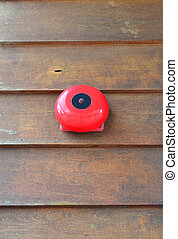Red fire alarm on wooden wall - Red fire alarm on grunge...