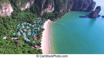 Aerial view flying over amaizing hotel houses towards...