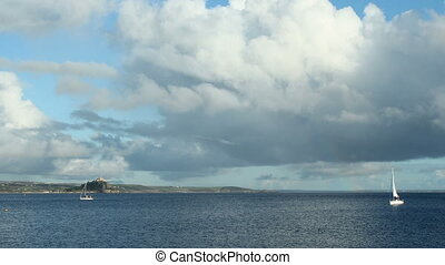 Timelapse clouds Mounts bay boats.