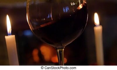 Red Wine glass in front of fireplace France
