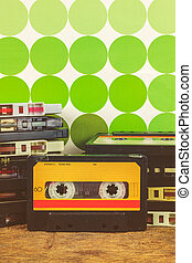Retro styled image of vintage audio compact cassettes on a...