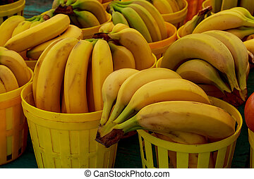 Yellow bananas on market place - Market with vegetable...