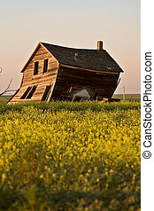 Weathered old farm house in scenic Saskatchewan