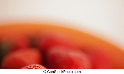 Strawberries on a plate - Ripe strawberry on orange plate.