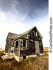 Abandoned old farm house in the Dirt Hills of Saskatchewan