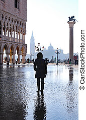 Venice Italy St Mark Square with high tide and a tourist...