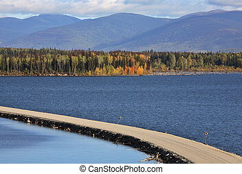 Causeway road over Williston Lake in beautiful British...