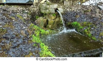 pure spring in the pipe - spring with drinking water clear...