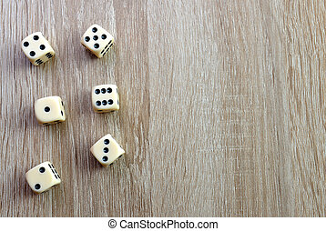 Dices on a wooden desk.