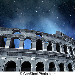 Flavian Amphitheatre or Colosseum in Rome with night sky in...
