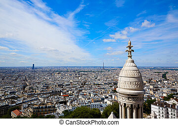 Paris skyline and Sacre Coeur Basilique in Montmartre at...