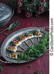 Christmas food - Tree like styled cheese and vegetables on...