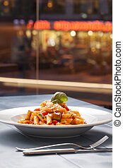 pasta on the city night life background