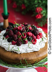 Raspberry cake - Cranberry and raspberry cake on red wooden...