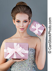 Young Woman with Prom Hairstyle Holding Pink Gift with Silky...