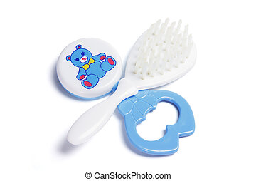 Baby Rattle and Hair Brush on White Background