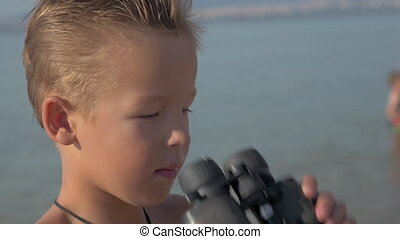 Little explorer with binoculars - Close-up shot of a child...