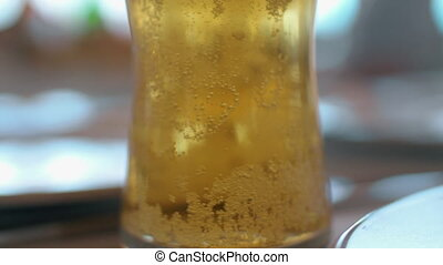 Light beer with bubbles - Close-up shot of a glass with cold...