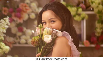 Woman and flowers. Asian girl portrait with bouquet - Woman...