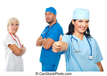 Successful group of doctors give thumbs - Successful group...