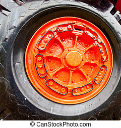 Wheel of vintage mining truck - Enormous wheel, rim and...