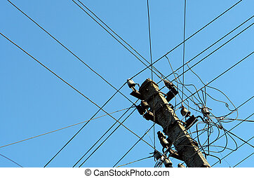 Electrical wires on pillar - Intertwining of many electrical...