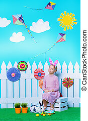 childrens imagination - Cute happy little girl sitting with...