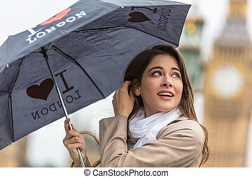 Woman Tourist With Umbrella by Big Ben, London, England