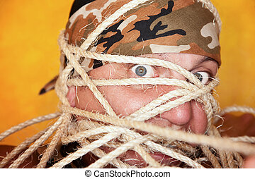Man wrapped in ropes