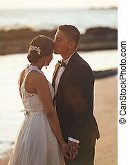 Kissing married wedding couple
