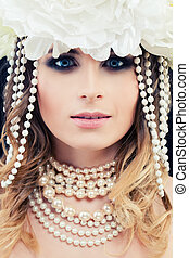Beautiful Woman Fashion Model with White Pearls and Flowers. Glamorous Beauty, Face Closeup