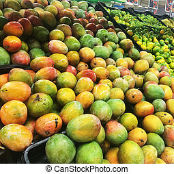 Market place with lots of colorful fruits and price tag