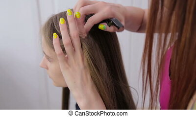 3 shots. Professional hairdresser doing hairstyle for young...