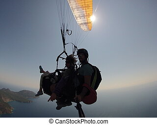 Fly in the sky above laguna Paragliding tandem