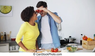 happy couple cooking food and having fun at home - cooking,...