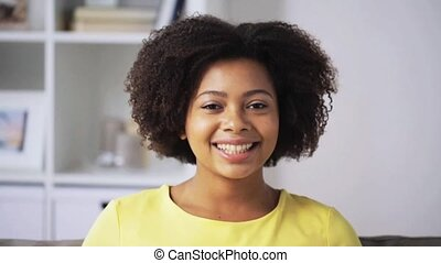 happy african american young woman face at home - people,...
