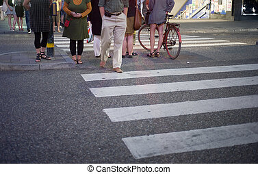 Crosswalk - People standing on a crosswalk at night in...