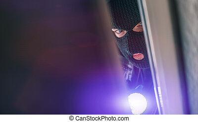 burglar - masked burglar with crowbar breaking and entering...