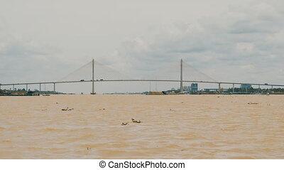 Bridge on the broad Mekong River. Shooting on the move....