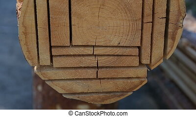 Cutted log into planks and beams. Close up view of modern...