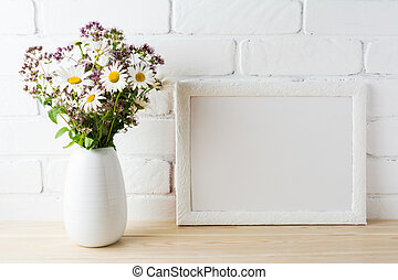 White landscape frame mockup with blooming wildflower...