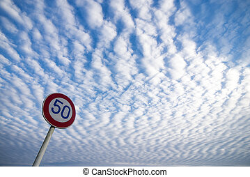 Traffic sign under wavy clouds in japan